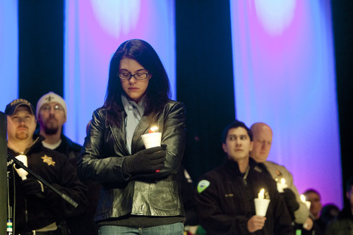 Kim Raff  |  The Salt Lake Tribune  Erin Francom widow of Agent Jared Francom, who was killed, and the five other officers who were wounded in a gun battle with a suspect the night before, attends a candle light vigil at the Ogden Amphitheater in Ogden on Jan. 5, 2012.