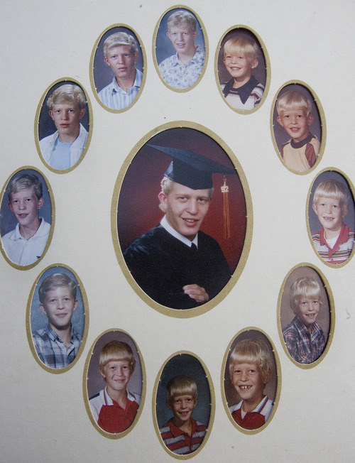 Paul Fraughton | The Salt Lake Tribune. A high school graduation photo surrounded by other yearly  school photos of Matthew David Stewart. photo provided by the Stewart family  Friday, January 6, 2012