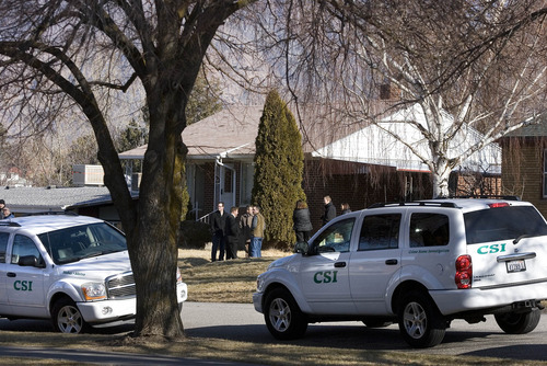 Paul Fraughton   The Salt Lake Tribune. Investigators continue their work Friday at the Ogden home where six police officers were shot, one fatally, on Wednesday night.