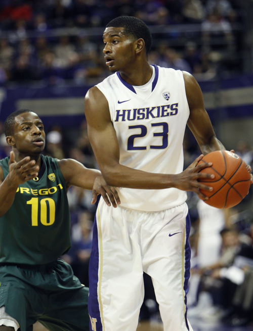 Oregon's Johnathan Loyd, left, defends Washington's C.J. Wilcox during the first half of an NCAA college basketball game in Seattle on Saturday, Dec. 31, 2011. Washington defeated Oregon 76-60. (AP Photo/Kevin P. Casey)