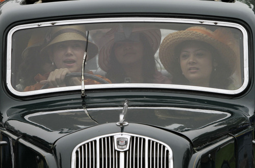 Indian woman Sucheta Dey drives a 1939 Morris during the Statesman Vintage and Classic Car Rally in Kolkata, India, Sunday, Jan. 8, 2012. 67 cars dating from year 1906 to 1939 participated in the annual event. (AP Photo/Bikas Das)