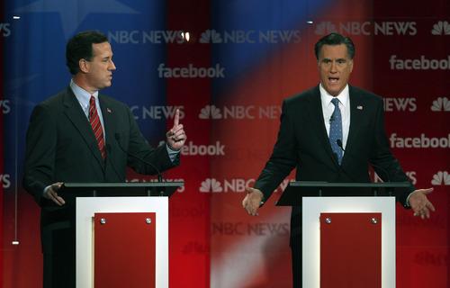 Former Pennsylvania Sen. Rick Santorum, left, and former Massachusetts Gov. Mitt Romney spar during a Republican presidential candidate debate at the Capitol Center for the Arts in Concord, N.H., Sunday, Jan. 8, 2012. (AP Photo/Charles Krupa)