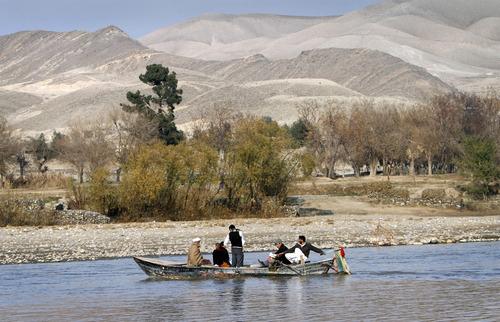 Afghans travel on a boat on the outskirt of Jalalabad, Nangarhar province east of Kabul, Afghanistan, Sunday, Jun. 8, 2012. (AP Photo/Rahmat Gul)