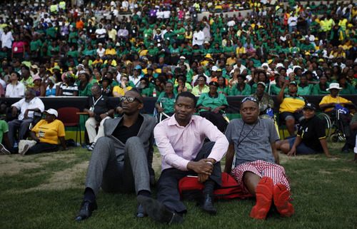 African National Congress (ANC) supporters listen to South African President Jacob Zuma address a crowd gathered for the ANC's 100th anniversary celebrations in Bloemfontein, South Africa, Sunday, Jan. 8, 2012. Tens of thousands of chanting and dancing revelers waved the green and gold colors of the African National Congress as Africa's oldest liberation movement celebrated its 100th anniversary Sunday, though many South Africans say the party hasn't delivered on its promises since taking power in 1994. (AP Photo/Jerome Delay)
