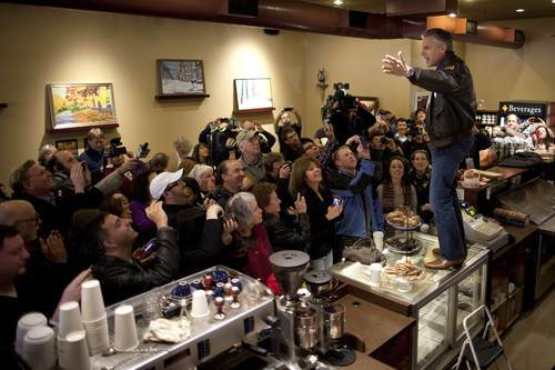 Republican presidential candidate, former Utah Gov. Jon Huntsman, stands on a counter during a campaign stop at the Bean Towne Coffee House on Sunday, Jan. 8, 2012 in Hampstead, N.H.  (AP Photo/Evan Vucci)