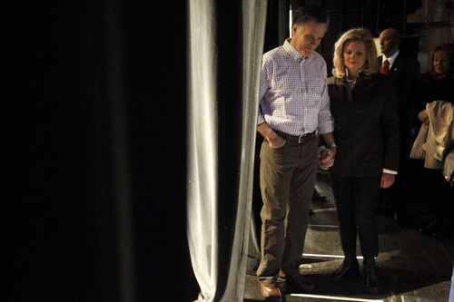 Republican presidential candidate, former Massachusetts Gov. Mitt Romney, holds hands with his wife Ann as they wait backstage while campaigning at the Rochester Opera House in Rochester, N.H., Sunday, Jan. 8, 2012. (AP Photo/Charles Dharapak)