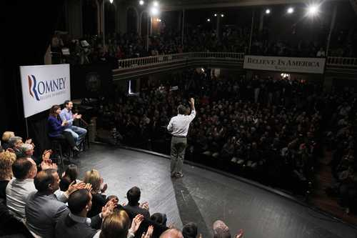 Republican presidential candidate, former Massachusetts Gov. Mitt Romney, campaigns at the Rochester Opera House in Rochester, N.H., Sunday, Jan. 8, 2012. Also seated on stage are former Minnesota Gov. Tim Pawlenty, left, and Sen. Kelly Ayotte, R-N.H. second left. (AP Photo/Charles Dharapak)