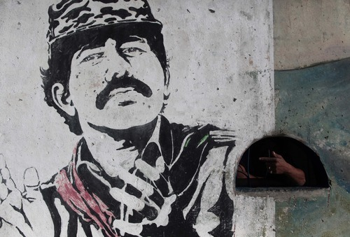 A 1980's mural depicting Nicaragua's re-elected President Daniel Ortega adorns a stadium wall in Esteli, Nicaragua, Sunday Jan. 8, 2012. The one-time Sandinista revolutionary, Ortega will be sworn in for a third term at Tuesday's presidential  inauguration in Managua. (AP Photo/Esteban Felix)