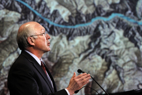 Interior Secretary Ken Salazar, standing in front of a projected map of the Grand Canyon, announces a twenty year ban on new mining claims near the Grand Canyon, Monday, Jan. 9, 2012, in Washington.  (AP Photo/Jacquelyn Martin)