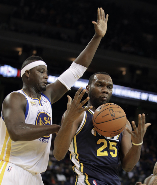 Utah Jazz's Al Jefferson (25) regains control of the ball as Golden State Warriors' Kwame Brown (54) defends during the first half of an NBA basketball game Saturday, Jan. 7, 2012, in Oakland, Calif. (AP Photo/Ben Margot)