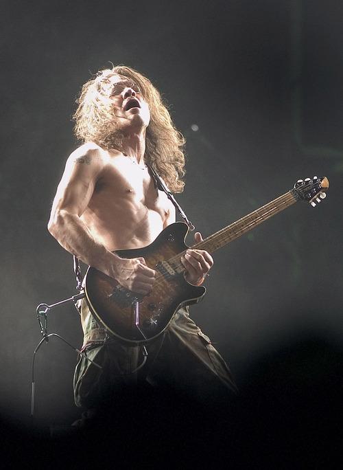 Eddie Van Halen jams during the Van Halen concert at the Delta Center Aug. 3, 2004. Griffin/photo 8/3/04