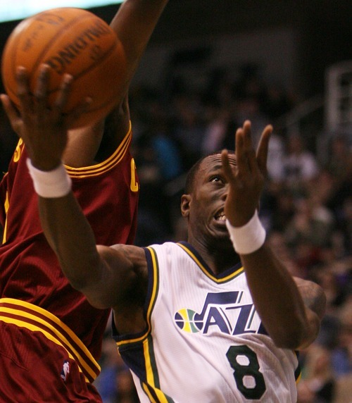 Steve Griffin  |  The Salt Lake Tribune  Utah's Josh Howard reverses the ball and scores during first half action in the Jazz Cleveland game at EnergySolutions Arena in Salt Lake City, Utah  Tuesday, January 10, 2012.