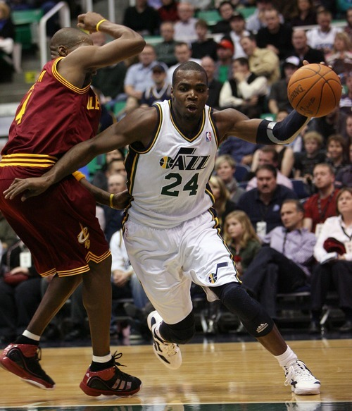 Steve Griffin  |  The Salt Lake Tribune  Utah's Paul Millsap drives around Cleveland's Antawn Jamison during first half action in the Jazz Cleveland game at EnergySolutions Arena in Salt Lake City, Utah  Tuesday, January 10, 2012.
