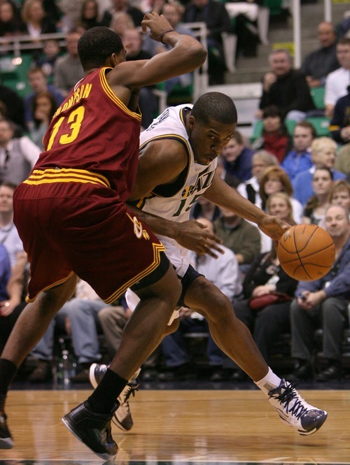 Steve Griffin  |  The Salt Lake Tribune  Utah's Derrick Favors drives past Cleveland's Tristan Thompson during first half action in the Jazz Cleveland game at EnergySolutions Arena in Salt Lake City, Utah  Tuesday, January 10, 2012.
