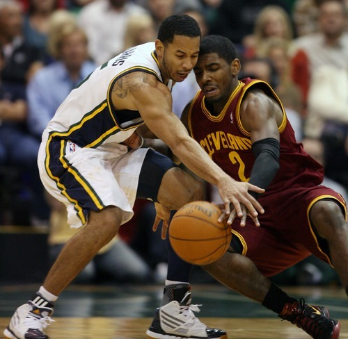 Steve Griffin  |  The Salt Lake Tribune  Utah's Devin Harris strips the ball from Cleveland's Kyrie Irving during second half action in the Jazz Cleveland game at EnergySolutions Arena in Salt Lake City, Utah  Tuesday, January 10, 2012. Harris was called for a foul on the play.