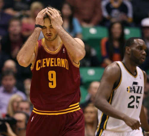 Steve Griffin  |  The Salt Lake Tribune  Cleveland's Semih Erden holds his head after being called for a foul during second half action in the Jazz Cleveland game at EnergySolutions Arena in Salt Lake City, Utah  Tuesday, January 10, 2012.