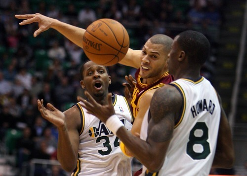 Steve Griffin  |  The Salt Lake Tribune  Utah's C.J. Miles and Josh Howard try and keep the ball away from Cleveland's Anthony Parker during second half action in the Jazz Cleveland game at EnergySolutions Arena in Salt Lake City, Utah  Tuesday, January 10, 2012.