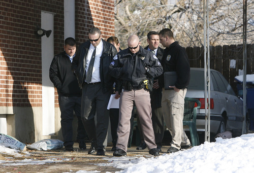Scott Sommerdorf  |  The Salt Lake Tribune                       Police investigators exit the home at 3268 Jackson Ave., in Ogden, where a fatal shoot out occurred last Wednesday. Later Monday, Weber County Attorney Dee Smith spoke at a press conference updating the investigation.  Monday, January 9, 2012.