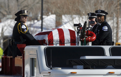Francisco Kjolseth  |  The Salt Lake Tribune Officers ride alongside the casket of slain Ogden police Officer Jared Francom as thousands turn up to pay their respects along the funeral procession route in Ogden on Wednesday, January 11, 2012.