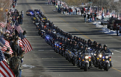 Francisco Kjolseth  |  The Salt Lake Tribune Thousands turn up to pay their respects for slain Ogden police Officer Jared Francom along the funeral procession route in Ogden on Wednesday, January 11, 2012.