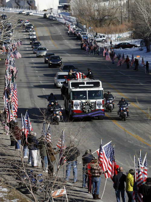 Francisco Kjolseth  |  The Salt Lake Tribune Thousands turn up to pay their respects for slain Ogden police officer Jared Francom along the funeral procession route in Ogden on Wednesday, Jan. 11, 2012.