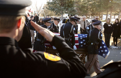 Trent Nelson  |  The Salt Lake Tribune Pallbearers with the casket at the graveside service at the Ogden City Cemetery for Ogden police officer Jared Francom, in Ogden on Wednesday, Jan. 11, 2012.