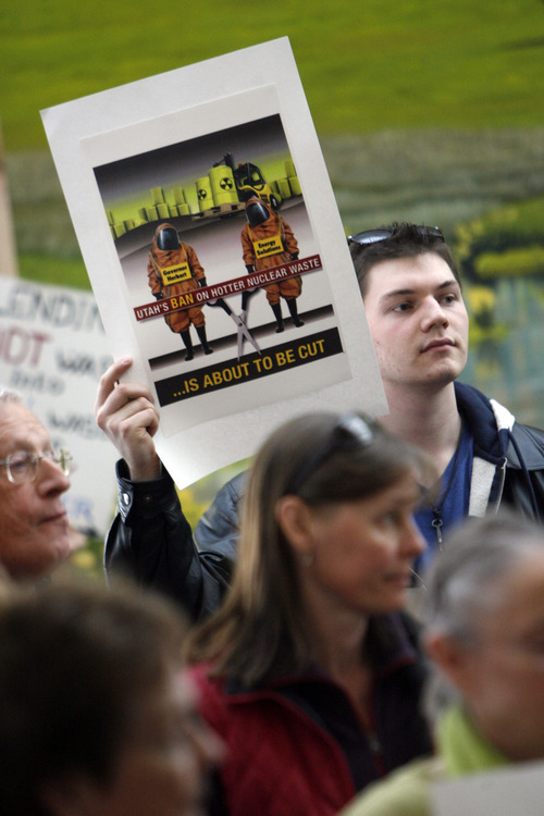 Francisco Kjolseth  |  The Salt Lake Tribune Peter Vanderhooft joins other concerned citizens gathered on Tuesday at the Department of Environmental Quality building in Salt Lake City to blast the state's decision to allow Energy Solutions to bury blended nuclear waste in the West Desert.
