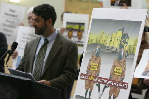 Francisco Kjolseth  |  The Salt Lake Tribune Matt Pacenza with the Healthy Environment Alliance of Utah speaks at a demonstration Tuesday at the Department of Environmental Quality building in Salt Lake City. The group blasted the state's decision to allow EnergySolutions to bury blended nuclear waste in the West Desert.
