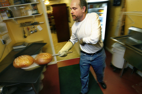 Scott Sommerdorf  |  The Salt Lake Tribune              Chris Stokes, chef and owner of the Happy Harbor Bread Co. in Bountiful, will deliver fresh-baked sourdough bread to customers near his Bountiful home. Customers order his homemade bread online then Stokes makes and bakes the loaves in a commercial kitchen.