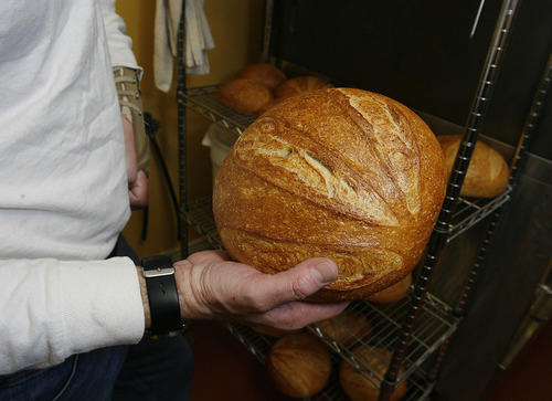 Scott Sommerdorf  |  The Salt Lake Tribune              One of Chris Stokes' finished loaves of sourdough. Stokes, chef and owner of the Happy Harbor Bread Co. in Bountiful, will deliver fresh-baked sourdough bread to customers nearby his Bountiful home. Customers order his homemade bread online then Stokes makes and bakes the loaves in a commercial kitchen.