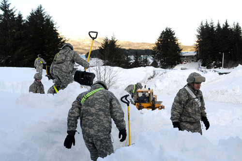 Alaska National Guard, guard members help dig out the fishing town of Cordova, Alaska National Guard troops are helping Cordova recover from massive snows that have collapsed roofs, trapped some people in homes and triggered avalanches. (AP Photo/Alaska National Guard)