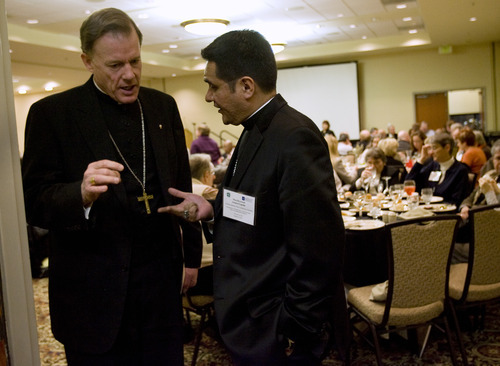 Kim Raff  |  The Salt Lake Tribune Bishop John C. Wester, left, from the Catholic Diocese of Salt Lake City, talks with Arturo Cepeda of the Archdiocese of Detroit before giving his keynote address during the U.S. Conference of Catholic Bishops' immigration conference in Salt Lake City at the Raddison Hotel on Jan. 11, 2012.