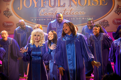 Dolly Parton, foreground from left, Keke Palmer and Queen Latifah are shown in a scene from
