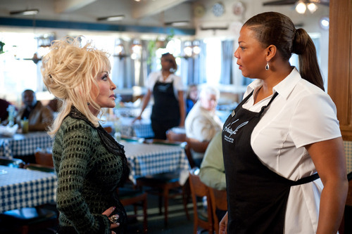 Dolly Parton, left, and Queen Latifah are shown in a scene from