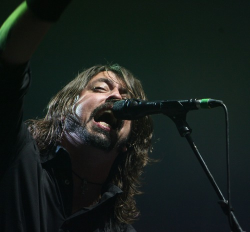 Steve Griffin  |  The Salt Lake Tribune   Foo Fighters lead vocalist Dave Grohl gets the crowd going during the first song of a concert at the Maverik Center in West Valley City on Tuesday, Oct. 11, 2011.