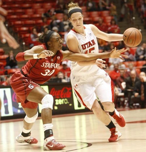 Chris Detrick  |  The Salt Lake Tribune Utah's Michelle Plouffe (15) runs around Stanford's Nnemkadi Ogwumike (30) during the game at the Huntsman Center Thursday January 12, 2012.