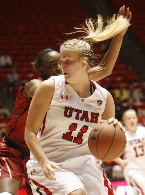 Chris Detrick  |  The Salt Lake Tribune Utah's Taryn Wicijowski (11) is guarded by Stanford's Nnemkadi Ogwumike (30) during the game at the Huntsman Center Thursday January 12, 2012.