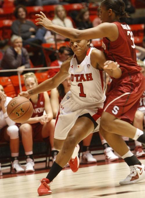 Chris Detrick  |  The Salt Lake Tribune Utah's Janita Badon (1) is guarded by Stanford's Amber Orrange (33) during the game at the Huntsman Center Thursday January 12, 2012.