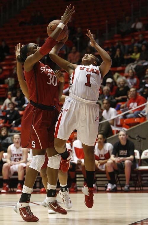 Chris Detrick  |  The Salt Lake Tribune Utah's Janita Badon (1) is blocked by Stanford's Nnemkadi Ogwumike (30) during the game at the Huntsman Center Thursday January 12, 2012. Stanford won the game 62-43.