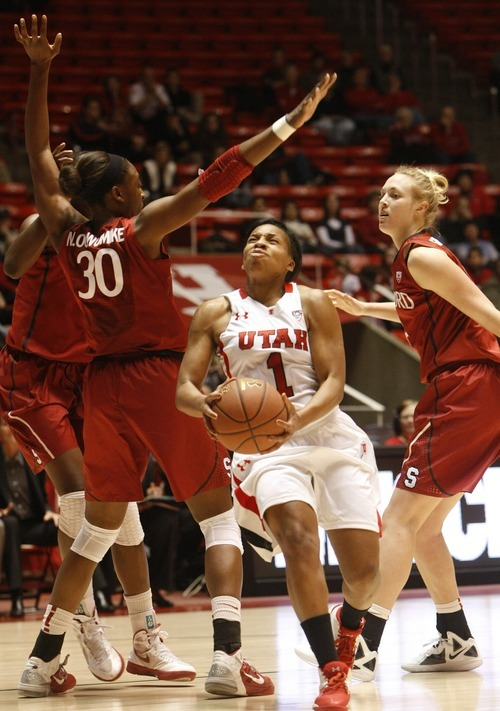 Chris Detrick  |  The Salt Lake Tribune Utah's Janita Badon (1) is guarded by Stanford's Nnemkadi Ogwumike (30) and Stanford's Taylor Greenfield (4) during the game at the Huntsman Center Thursday January 12, 2012.