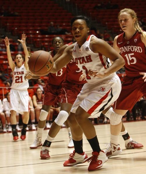 Chris Detrick  |  The Salt Lake Tribune Utah's Janita Badon (1) is guarded by Stanford's Lindy La Rocque (15)  during the game at the Huntsman Center Thursday January 12, 2012.