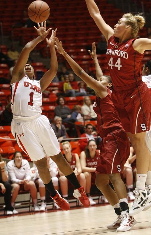 Chris Detrick  |  The Salt Lake Tribune Utah's Janita Badon (1) shoots past Stanford's Amber Orrange (33) and Stanford's Joslyn Tinkle (44) during the game at the Huntsman Center Thursday January 12, 2012.