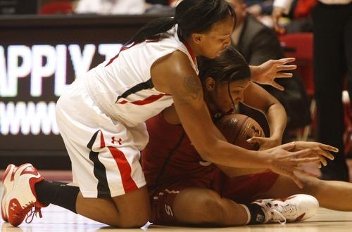 Chris Detrick  |  The Salt Lake Tribune Utah's Janita Badon (1) and Stanford's Amber Orrange (33) go for the ball during the game at the Huntsman Center Thursday January 12, 2012. Stanford won the game 62-43.