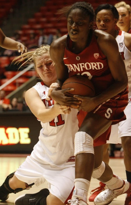 Chris Detrick  |  The Salt Lake Tribune Utah's Taryn Wicijowski (11) fights for the ball with Stanford's Nnemkadi Ogwumike (30) during the game at the Huntsman Center Thursday January 12, 2012. Stanford won the game 62-43.
