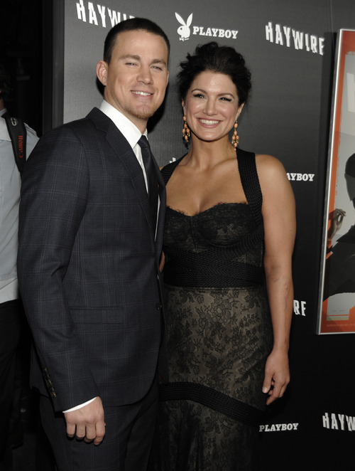 Actor Channing Tatum, left, and actress Gina Carano arrive at the premiere of the feature film
