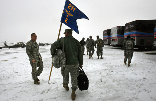 Scott Sommerdorf     The Salt Lake Tribune              First Sgt. Joel Hutchings heads toward the buses carrying the unit