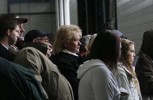 Scott Sommerdorf     The Salt Lake Tribune              Family members soberly watch from the hanger as 260 Soldiers of the Utah Army National Guard's First Battalion, 211th Aviation leave on the first leg of their 12-month deployment to Afghanistan, Monday January 16, 2012.