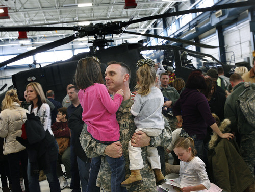 Scott Sommerdorf     The Salt Lake Tribune              A Lieutenant in the 211th says a goodbye to two little girls as 260 Soldiers of the Utah Army National Guard's First Battalion, 211th Aviation prepare to leave on the first leg of their 12-month deployment to Afghanistan, Monday January 16, 2012.