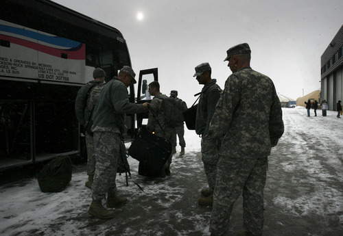 Scott Sommerdorf     The Salt Lake Tribune              Some of the 260 Soldiers of the Utah Army National Guard's First Battalion, 211th Aviation prepare to leave on busses on the first leg of their 12-month deployment to Afghanistan. Pilots of the 1-211th will leave on their AH-64D helicopters, bound for Fort Hood, Texas, and the non pilots will be bussed to the airport for commercial flights, Monday January 16, 2012.