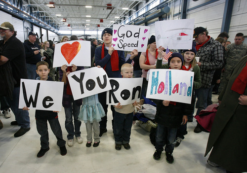 Scott Sommerdorf     The Salt Lake Tribune              The Holland family says goodbye to their loved one as soldiers of the Utah Army National Guard's First Battalion, 211th Aviation leave on the first leg of their 12-month deployment to Afghanistan. Pilots of the 1-211th will leave on their AH-64D helicopters, bound for Fort Hood, Texas, and the non pilots will be bused to the airport for commercial flights, Monday January 16, 2012.